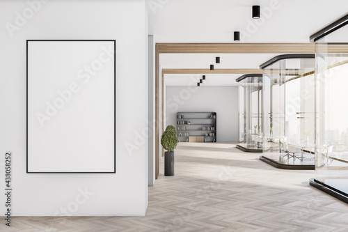 Fotografia Modern corporate office interior with empty poster on concrete wooden glass wall, furniture and daylight