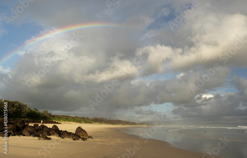 Fotografiet Rainbow in early morning at the beach of Byron Bay, Australia.