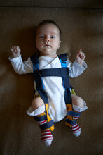 A Baby Wearing Pavlik Harness To Correct Small Hip Problems