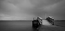 Pier At The Beach On A Cloudy Day