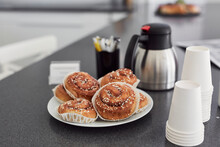 View Of Disposable Cups And Cinnamon Buns