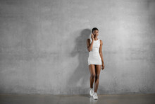 Stylish Black Model Talking On Smartphone On Gray Background