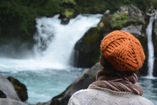Woman From Behind With Orange Beret Watching The Water Fall In A Waterfall
