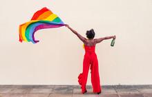Black Woman In Stylish Wear With LGBTQ Flag