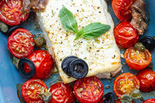 Baked Cherry Tomato Halves With Feta Cheese In Baking Pan