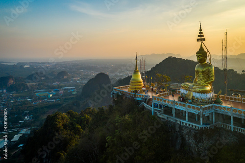Aerial view from drone of Wat Tham Suea (The Tiger Cave temple) during sunset well-known temple on a hilltop in Krabi, Thailand Fototapeta