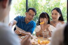 Asian Family Having A Happy Meal