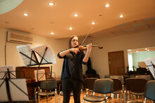 Female Violinist Performing Classical Music In Hall