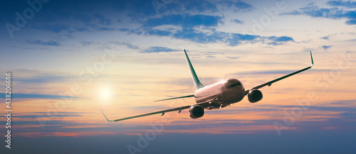 Slika na platnu Passengers commercial airplane flying above clouds