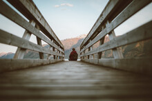 Tourist Enjoying View From Wooden Boardwalk In Highlands