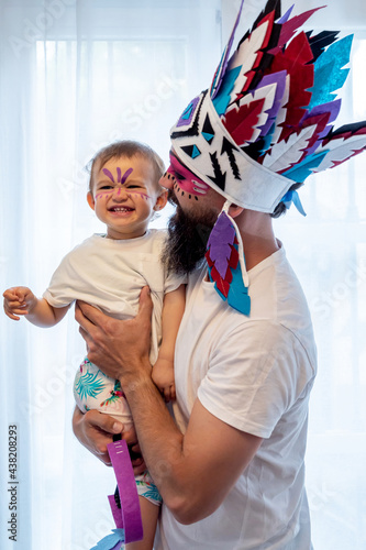 Father holding his toddler with indian costumes at home Fototapeta
