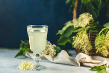 Soft Drink With Ice Cubes From Elderflower Syrup, Juice Or Champagne In A Glass