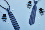 Father's Day poster or banner with necktie and decorations on blue background. Greetings for Father's Day. Flat lay styling.