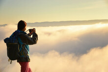 Silhouette Of A Woman Standing On A Mountain Above Cloud Carpet With Her Arms Outstretched, Thailand
