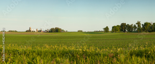 Panorama of a farm and fields on a sunny spring evening in Minnesota #438240670