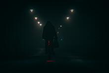 Cyclist In Park At Night Under Heavy Fog In Spooky Winter Scene In Glasgow