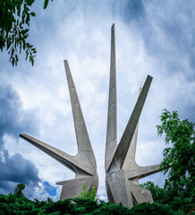 Monument on Serbia mountain Kosmaj. Big concrete monument with cloudy sky. Monument to the Fallen Soldiers