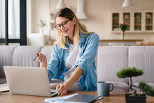 Young Businesswoman Working On Laptop As A Freelance Job, Part-time Occupation At Home Office, Remote Job During Lockdown.Student E-learning At Unversity, Tutor And School Teacher Online Classes