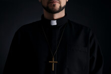 Priest Wearing Cassock With Clerical Collar On Dark Background, Closeup