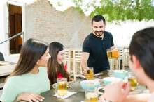 Cheerful Friends Asking For Another Cold Beer