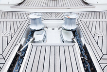 Bow Of Teak Deck, Luxury Yacht With Stainless Steel Winches And Anchor Chain Fixing Mechanisms.