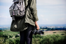 Woman With Camera In The Nature