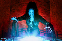 The Witch Conjures On A Mysterious Table In The Stone Basement Of A Mysterious House Illuminated By Blue And Red Light