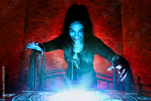 Tela The witch conjures on a mysterious table in the stone basement of a mysterious h