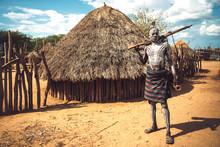Man With Painted Body Holding A Shotgun In Karo Tribe Village. Omo Valley, Ethiopia