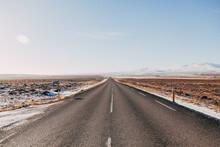 Asphalt Road On Snowy Landscape