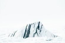 Frozen Mountain Peak In Arctic Terrain