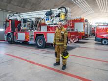Professional Fireman Standing Near Fire Truck