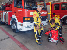 Professional Firemen Climbers Fire Engine Preparing Fire Fighter