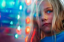 Portrait Of Sad Little Girl In The Amusement Park