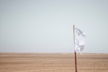 White Flag In Arid Desert