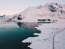 Road On Shore Near Mountain In Snow And Water