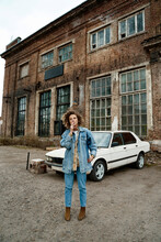 Woman Standing Near Old Car In Abandoned Place
