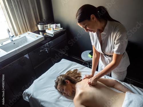 Carta da parati Woman having massage of body in the spa salon