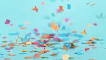 Color Confetti Falling On Pastel Blue Background, Macro Shot.
