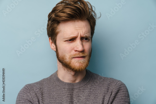 Fotografia White ginger man with beard frowning and looking aside