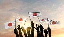 Silhouette Of Arms Raised Waving A Japan Flag With Pride. 3D Rendering
