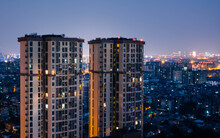 Long Exposure Night View On Tall Skyscrapers Residential District Buildings, City Background. Beautiful Night View Cityscape Of Chinese Metropolis Chengdu.