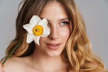 Half-naked Blonde Woman Looking Aside While Posing With Daffodil