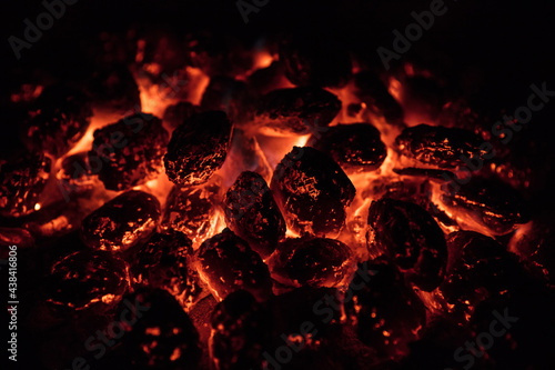 Glowing Hot Charcoal Briquettes on garden grill, close-Up, Top View #438416806