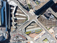Birmingham New Street Grand Central Station England UK Aerial View Of City Centre With Crossroads Train Station. Big Transport Hub With Trains At Platforms On Sunny Day Drone Perspective.