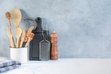 Stylish Kitchen Background With Kitchen Utensils On Marble Countertop, Empty Space For Text, Front View. Minimal Cooking Space With Tableware.