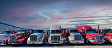 Semi Trucks Lined Up On A Parking Lot At Logistics Warehouse