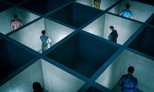 People Trapped In Small Concrete Rooms With Sectors.