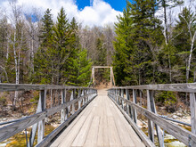 A Wooden Bridge On The Mountain Pemigewasset River In The Forest. Lincoln Woods Trail In The White Mountains