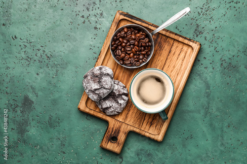 Fotografiet Cup of freshly brewed coffee and cookies on color background